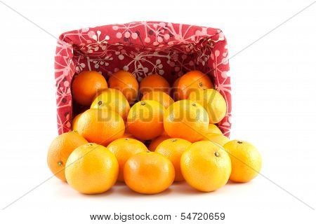 Mandarins Or Tangerines Are Poured Out Of The Basket