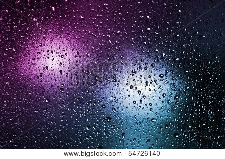 Colored Background Of A Glass With Waterdrops
