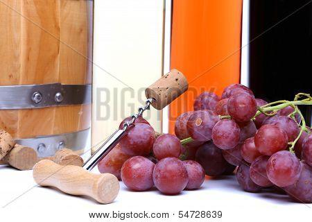 Corkscrew, cork, grape. Barrel and bottles.