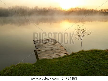 Lake with early morning fog