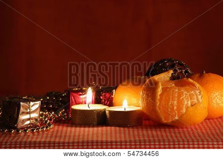 Still Life With The Candle And Mandarines.