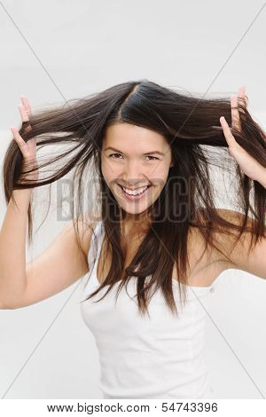 Joyful Woman Playing With Her Hair