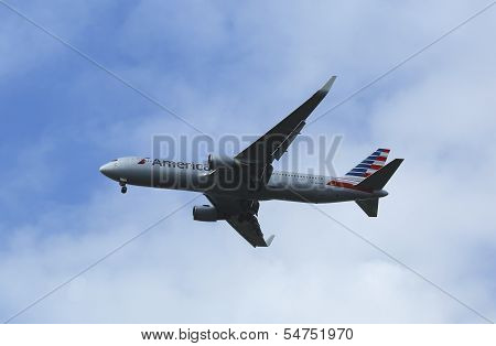 American Airlines Boeing 767 in New York sky before landing at JFK Airport