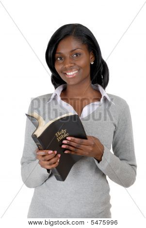 Young Woman Smiling With Opened Bible