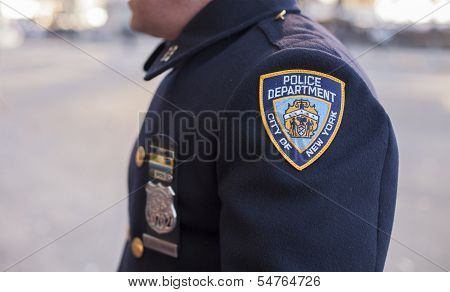 Arm of NYC police officer in 2013 Macy's Thanksgiving Day Parade