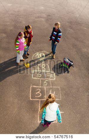 Kids Play Hopscotch