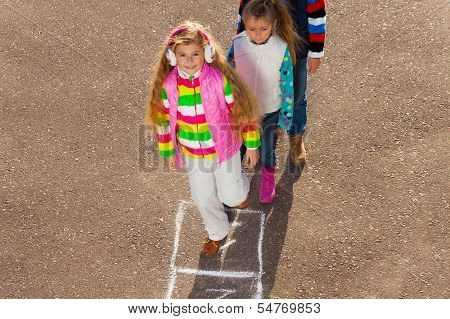 Girl Jumps On On Hopscotch