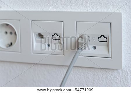 Network Cable Into An Outlet