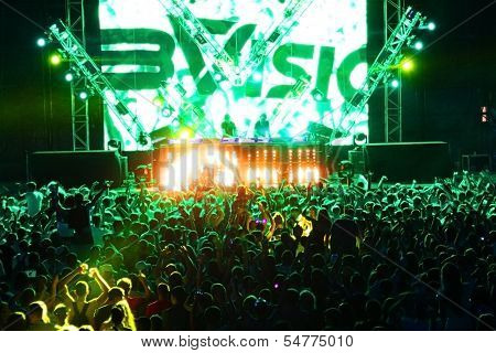 MINSK, BELARUS - JULY 6: Global Gathering Festival crowd at Borovaya airfield on July 6, 2013 in Min