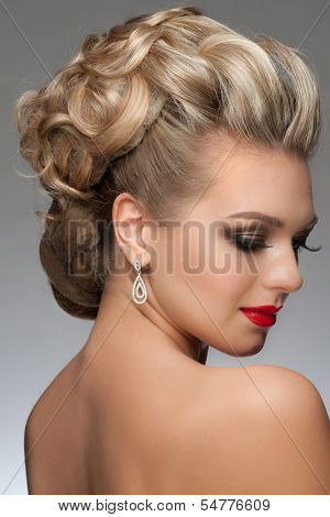 Portrait of beautiful young woman with stylish bright makeup and hairstyle. Woman with red lipstick