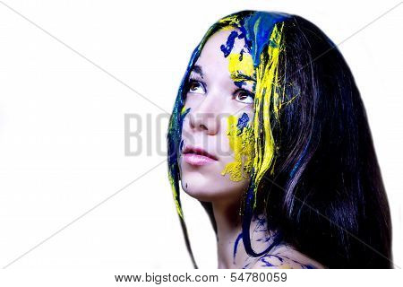 Beauty fashion close up portrait of woman painted blue and yellow on white background