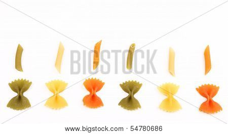 Composition of different pasta in three colors.