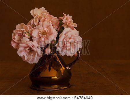 Pink roses in brown lustre ware jug