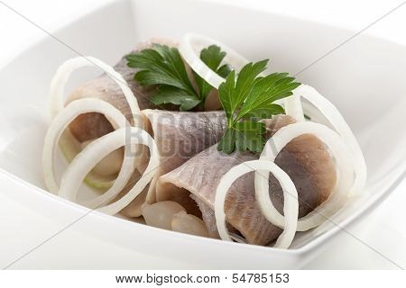 Herrings With Sliced Onion In White Bowl