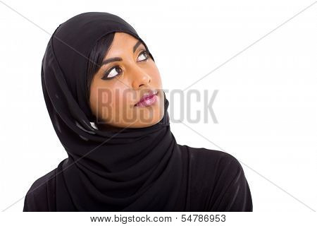 pretty muslim woman looking up on white background