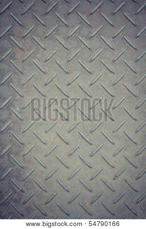 Rusty metal background with non slip repetitive pattern
