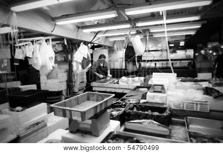 Tokyo- Nov 26: Worker Processing Fish At The Tsukiji Wholesale Seafood And Fish Market In Tokyo Japa