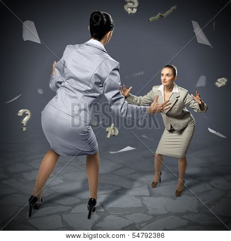 two businesswomen fighting as sumoist