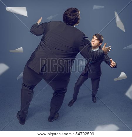two businessmen fighting as sumoist