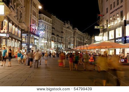Tourists walk at night in center of Vienna