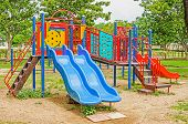 stock photo of playground school  - Colorful playground equipment in the public park - JPG