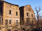 stock photo of xx  - Old abandoned brick apartment building built in the early XX century - JPG