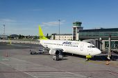 RIGA, LATVIA - JUNE 13, 2011: airBaltic Boeing 737 docked in Riga airport. June 13, 2011. AirBaltic