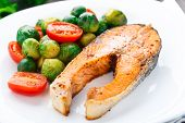 pic of brussels sprouts  - Salmon with roasted brussels sprout and tomato on a plate - JPG