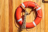 pic of copenhagen  - Orange lifebuoy on old sailing ship in Amaliehaven Copenhagen Denmark - JPG