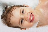 stock photo of bathtime  - Happy kid having a bath in shampoo - JPG