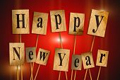picture of cubit  - Happy New Year text cut out letters - JPG