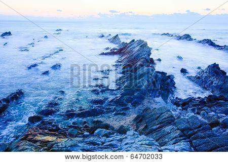 Beautiful sunrise over cretaceous sedimentary rock coastline