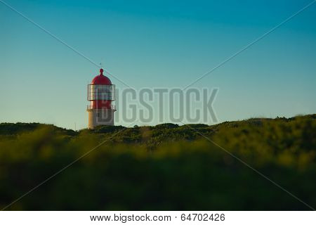 Lighthouse over green