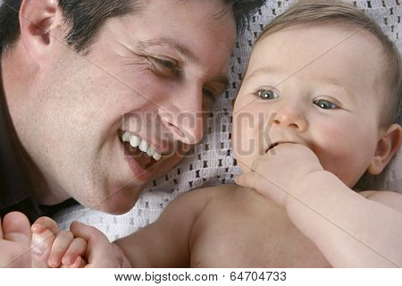 Happy father with cute baby girl