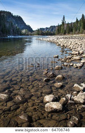 Stone Rocks On The Shore Of A Mountain River, Lake. Blue Sky.