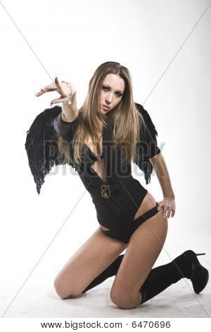 Portrait Of Sexy Woman In Lingerie With Black Wings