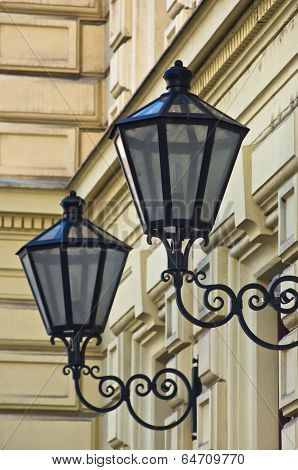 Typical stylish lanterns on 19th century neoclassic building dominant in Vienna