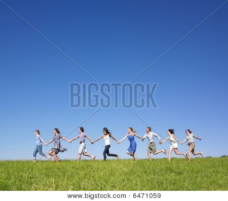 Group Holding Hands Running