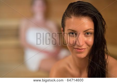 Closeup of smiling sweaty woman in the sauna