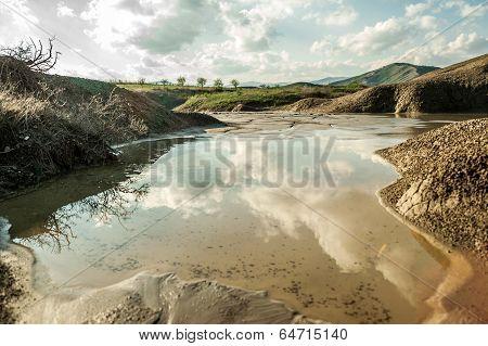 Small lake near muddy volcanoes