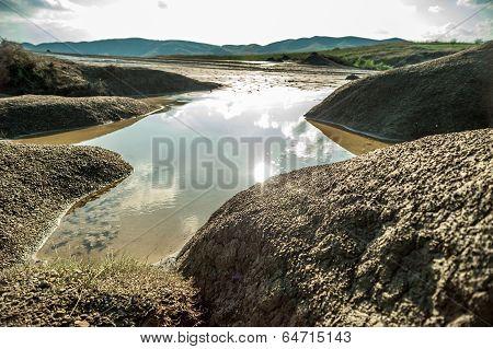 Rain water reservoir over muddy volcanoes