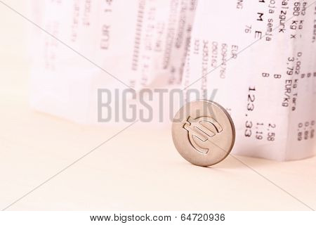 Euro Coin Symbol Rolled Down Bills In Background