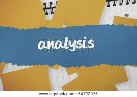 The word analysis against yellow paper strewn over notepad