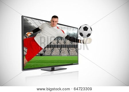 Composite image of fit goal keeper saving goal through tv against vast football stadium with fans in white