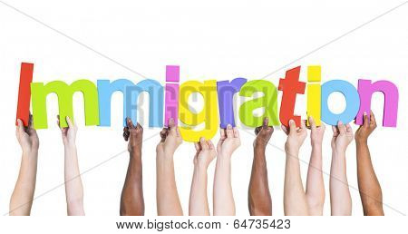 Diverse Hands Holding the Word Immigration