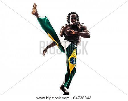 one Brazilian black man dancer dancing capoeira on white background