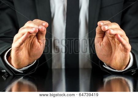 Businessman Making A Protective Gesture