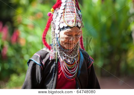 MAE HONG SON, CHIANG MAI, THAILAND - DEC 4, 2013: Unidentified Akha indigenous hill tribe woman in traditional clothes. Asian ethnic tribal group. Popular tourist travel destination in north Thailand