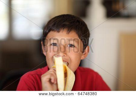 Young Boy Eating A Banana