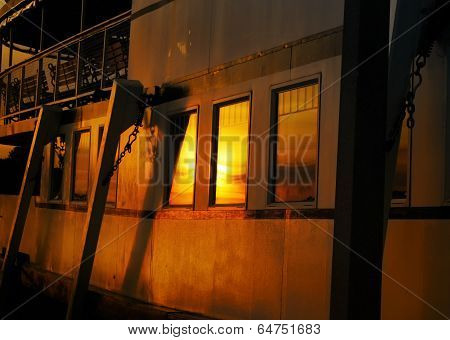 Side View of a Steamship Bathed in Sunset Glow
